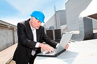 Businessman checking industrial site