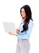 A pretty young businesswoman holding a laptop on a white background