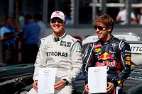 Sebastian Vettel GER Red Bull Racing & Michael Schumacher GER Mercedes GP, F1, Australian Grand Prix, Melbourne, Australia
