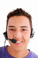 Smiling young man with telephone headset isolated on white backg
