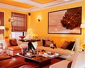An eclectic contemporary living room decorated in warm yellow tones