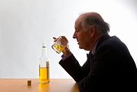 Senior businessman drinking whisky