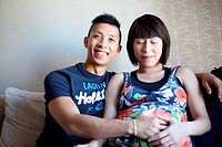 Happy Asian expectant couple