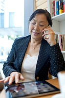 senior businesswoman using tablet PC