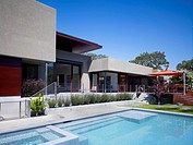 Patio and pool behind modern house