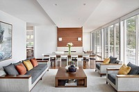 Modern living room with floor to ceiling windows that look out to lake Michigan.