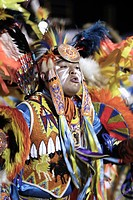 USA, Arizona, Scottsdale. Participant in an inter_tribal dance at the Red Mountain Eagle powwow held at the Salt River Pima_Maricopa Indian Community.