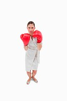Portrait of a serious businesswoman with boxing gloves