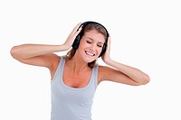 Happy woman dancing while listening to music