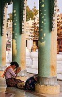 Myanmar, Nyaung U, Pagan, woman praying at temple