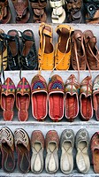 Leather sandals and slippers display Udaipur Rajasthan India