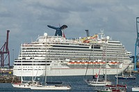Cruise ship Carnival Breeze maneuvering leaving Las Palmas port on Gran Canaria, Canary Islands, Spain