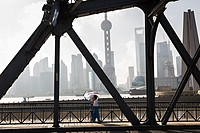People walk across the Waibaidu Bridge over Suzhou River Shanghai, China
