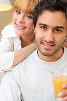Couple with a glass of orange juice
