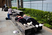 People dozing on a bench in The City