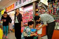 China, Shanghai, Huangpu District, Yuyuan Garden, Fuyou Road, shopping, market, marketplace, display, for sale, small business, Asian, man, father, wo...