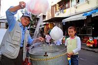 China, Shanghai, Huangpu District, Dongtai Road, cotton candy vendor, Asian, man, girl,