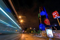 Tram light trail and Torre Agbar decorated with Christmas lights, Barcelona, Catalonia, Spain