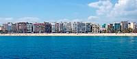Panoramic cityscape of Lloret de Mar from sea, Costa Brava, Spai