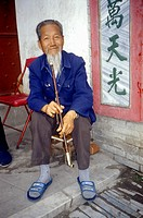 Old man with pipe in Dali, Yunnan Province, Peoples Republic of China