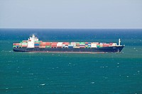 Large cargo ship bringing cargo containers to Durban, South Africa on the Indian Ocean