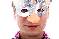 Smiling man wearing party mask, isolated on white background