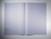Folded paper on white background
