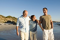 Grandfather, father and son 12_13 on beach