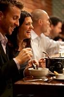 people eating together at restaurant