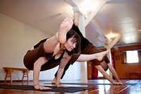 Couple practicing yoga in yoga studio