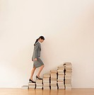 business woman walking up steps