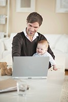 Happy Father and Son Looking at Laptop