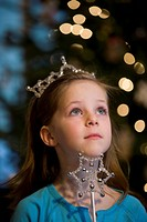 Young girl with tiara and wand