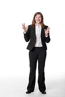 Caucasian businesswoman with arms raised