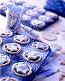 Icing sprinkled over mince pies