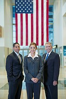 Business people standing together near American flag