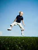 Low angle view of a girl jumping and smiling