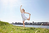 Germany, Cologne, Young woman dancing