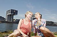 Germany, Cologne, Young women drinking beer
