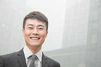 Smiling Chinese businessman