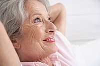 Spain, Senior woman relaxing, smiling