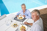 Spain, Senior couple having lunch at Mallorca