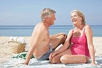 Spain, Mallorca, Senior couple sitting at beach