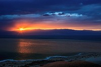 Dramatic sky at sunrise over the dead sea, israel