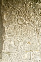Carving on the stone wall of stela portraying a mayan king in the great plaza at tikal national park, peten, guatemala