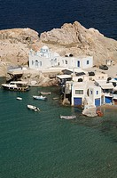 Buildings and boats moored along the coast, firopotamos, island of milos, greece