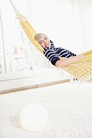 Germany, Bavaria, Munich, Woman relaxing in hammock, portrait