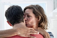 Spain, Mid adult woman kissing to man (thumbnail)