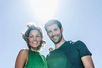 Spain, Mid adult couple smiling, portrait