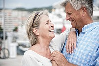 Spain, Senior couple at harbour (thumbnail)